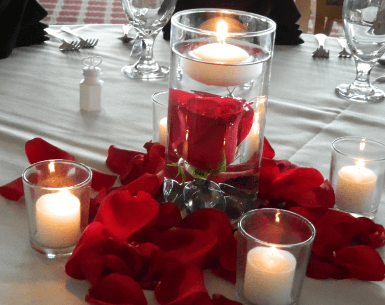 Simple and modern Floral Centerpiece with red roses and candle